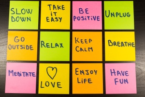 slow down, relax, take it easy, keep calm, love, enjoy life, have fun and other motivational lifestyle reminders on colorful sticky notes